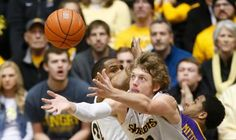 Wichita State guard Ron Baker reaches for a rebound during the first half against Northern Iowa at Koch Arena on Saturday.