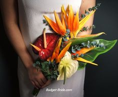 Would look nice with the blue dress for the vow renewal, and orange, yellow & red flowers were what we had at our first wedding!