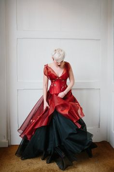 The couture company alternative bespoke custom made quirky  wedding dresses vintage gothic corset corsetted bride embroidered embroidery ruby red black feather wrap and petticoat skirt