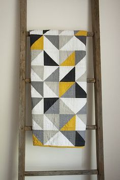Modern quilt inspiration: CHEVRON THROW. And the blanket ladder is a perfect way to display and make handy. We do sit on our quilts, don't we, Mary Ellen?