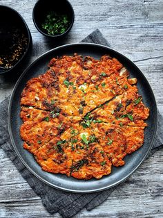 A savory, thin pancake loaded with kimchi and fried to crispy perfection in a cast iron pan. Kimchi pancakes are good as an appetizer or a late night snack. Pancakes For Dinner, Savory Pancakes, Kimchi Pancakes, Dinner Party Appetizers, Great Appetizers, Korean Dishes, Korean Food, Vietnamese Food, Vegetarian Recipes