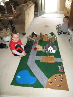Kaden & Blake with the farm play mat