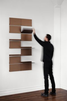 Riveli Shelving (Luxe Series) is a modular shelving system comprised of individual pivoting aluminum shelves that create a wall-mounted, easy-to-install system. Shelving configurations can change in an instant to disp. Modular Walls, Modular Shelving, Modular Storage, Shelving Systems, Modular Furniture, Design Furniture, Furniture Layout, Home Office Furniture, Luxury Furniture