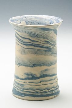 "swirly white/blue blended clay vase from Adventuresinclay on Etsy. ""I mixed my own blue clay by adding cobalt oxide to my white clay. Then I blended the blue with the white stoneware/porcelain clay together and threw this unglazed vase on my potter's wheel to create a unique pattern."""