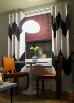 decorate by painting your own curtains. great for every room. also want those brown bamboo shades on every window. with curtains
