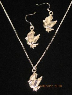 Silver dove in flight pendant and earrings set