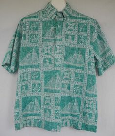 c422e33a Blue reverse print aloha shirt by Reyn Spooner. Graphics include the  Hawaiian flag, flowers and a bird/duck.