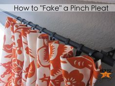 Attach curtain rings to the back of the curtain to make the top look pinch pleated
