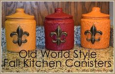 "old world style fall kitchen canisters, crafts, kitchen design Materials I used for this project:  Glass Apothecary Jars  (Jar Store) Zinsser Primer  (Wal-Mart) Dry Dex Spacking Compound  (Wal-Mart) Spacking Knife  (Wal-Mart) Sponge Brush  (Wal-Mart) Basic Paint Brush  (Wal-Mart) Paint Samples in 3 colors  (Home Depot) 3- 4"" Polystone fleurs-de-lis  (Hobby Lobby) Gorilla Glue  (Wal-Mart)"