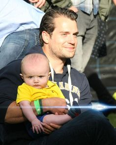 Henry Cavill at the Irish Festival holding a fan's baby. The look on the baby's face....