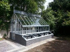 Blue brick, steel greenhouse finished in blue.... Period design greenhouses manufactured using welded mild steel, zinc treated, powder coated to a choice of colour, these greenhouses are elegant, robust. Virtually maintenance free, will withstand all weather conditions and be here for generations to come. VictorianGreenhouses.com