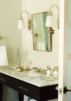 bathrooms - lucite pulls, lucite hardware, cabinet hardware, vanity hardware, bathroom vanity hardware, black vanity, rectangular pivot mirror,