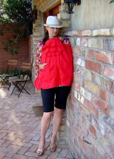 Very cool idea for a nursing cover. I love the ruffles and the pocket! This would be super easy to stitch up.