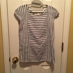 Ann Taylor blue and white striped t-shirt - M Classic summer staple!  Medium sized Ann Taylor tee in a striped print.  Stripes are horizontal in the front and back and vertical along the sides for a slimming effect.  SO soft!  Looks like linen but it is actually cotton.  Very versatile- can be dressed up or down. Great gently used condition. Ann Taylor Tops Tees - Short Sleeve