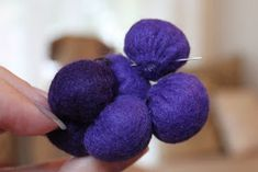 Supplies needed:Purple felt (varying shades)  Fiber fill  Needle and thread  Green pipe cleaner   Cut approximately 33 circles, with a ...
