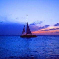 """Aruba Sail Boat"" by Carter L. Shepard"