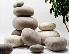 """Handmade, hand-dyed and hand-felted from 100% wool, these cool, modern and distinctly zen rock pillows come in a variety of sizes ranging from small pebbles to large boulders."""