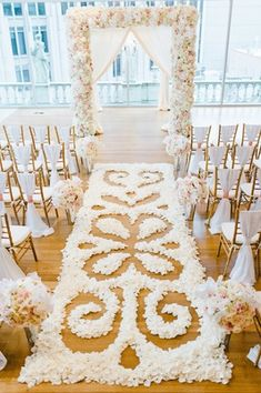 Intricate Flower Petal Aisle Runner    Photography: Crystal Stokes Photography   Read More:  http://www.insideweddings.com/weddings/white-blush-inspirational-wedding-shoot-at-urban-rooftop-garden/714/