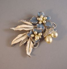 Blue and white enameled flowers and leaves brooch