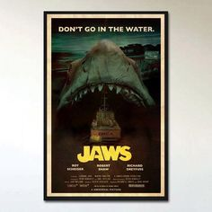 """This is an alternative retro movie poster print for the 'Jaws', designed by Ehron Asher. Inspired by posters from B-Movie monster films of the late 60's and early 1970's such as 'Creature From Black Lake', 'The Crater Lake Monster', and 'It Lives By Night', and features Brody, Hooper, and Quint motoring somewhere along Amity, on the Ocra, directly into the jaws of Bruce the shark. 11""""x17"""", professionally printed on 100lb high-quality paper with a silk finish. Silk finish is similar to a…"""