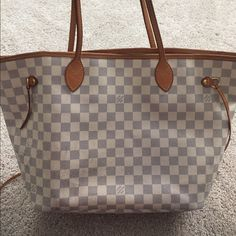 Authentic Louis Vuitton neverfull mm  authentic damier azur neverfull mm. Fair to good condition. Few things to know. One of the side straps is broken (easy fix at LV). The exterior and interior are dirty (could use a day at the handbag spa). Tobacco odor.  I can add any additional pics you might need.  This will also go through posh authentication service for worry free shopping  Louis Vuitton Bags