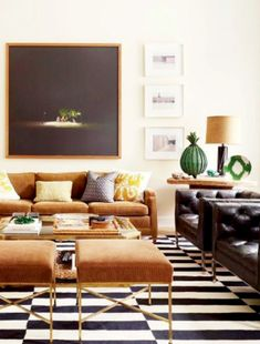 In designer Nate Berkus's Manhattan family room, a large photograph by Oswaldo Ruiz overlooks a vintage Milo Baughman chair, at left, and a pair of Paul McCobb stools; saguaro-cactus skeletons stand in the corner. Living Room Modern, My Living Room, Living Room Designs, Living Room Furniture, Living Room Decor, Masculine Living Rooms, Small Living, Bedroom Decor, Masculine Room