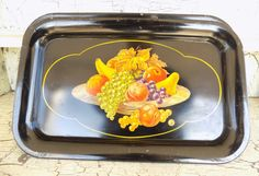 Black Enamel Metal Trays, Fruit Bowl Lithograph, Mid Century, Set of 4 Serving Tray, Vintage Cafe Decor. Measures 14 1/4 long and 9 wide approximately. About 7/8 deep.  Shiny black enamel with a fruit bowl lithograph. Set of 4 trays in this listing.  Perfect to add color to a vintage kitchen shelf or wall.  Use for restaurant decor, photo shoots, and bar areas. Imagine serving tea or lemonade on this tray, coffee or lattes.  Use for grandkids visiting, so many ways to enjoy a good m...