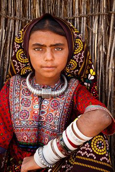 Portrait of a girl from the nomadic Fakirani Jat tribe wearing traditional clothing near the village of Chhadvara, located roughly 100km from Bhuj in the Kutch District
