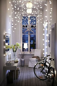 This entry excellently uses decorative lighting to make the best use of their high ceiling.
