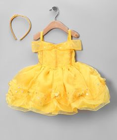 This set is filled with all the fairy-tale fancy needed to make girls feel like princesses. The dress boasts a button-up back and scatterings of shimmering stars on the off-shoulder sleeves and ruffled trim. With a prim headband topping it off, this dress-up dream is the belle of every ball.