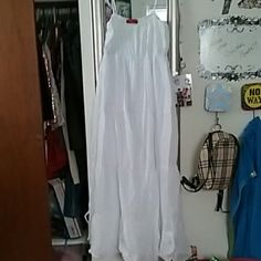 Flowy white sheer peasant dress size 1x-2? This white flowy dress is super comfy and has tie up straps that you can use or tuck into the top. The upper back is smocked for comfort and it is lined underneath to the thigh area. This dress was more sheer than I anticipated so I think it would be perfect for the beach or a pool party. Never worn. Shorter maxi length. Marmalade Moon Dresses Maxi
