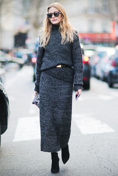Olivia Palermo wears a chunky knit dress belted with black pointed toe booties