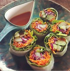 - Cucumber  - Avocado  - Carrots  - Cabbage  - Slice the above and roll into Bánh Tráng Trộn !!!! spring rolls.    To make the Spicy Peanut Dipping sauce    - Mix 1/2 tbs natural peanut butter with lemon juice, 1 tsp rice vinegar, dash of ginger, red pepper and sea salt.    Can't find the spring rolls? Just toss the ingredients in a bowl and drizzle the sauce over :)