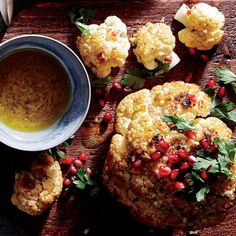 "For a bit of showmanship, bring the whole cauliflower to the table, and then ""carve"" and dress with the vinaigrette, pomegranate arils, pine nuts, and parsley."