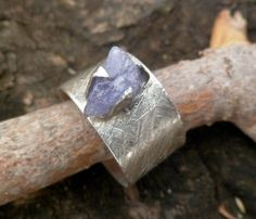 Hey, I found this really awesome Etsy listing at https://www.etsy.com/listing/173057276/raw-tanzanite-ring-adjustable-ring