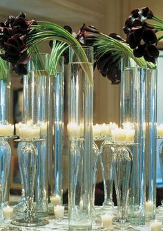 The bar will have a single arrangement of black calla lilies in a white cylinder vase