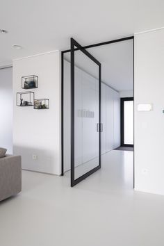 """Modern glass pivot door with invisible pivot hinges. The door is made with black anodized aluminium and features the award winning """"Stealth Pivot"""" hinge system. Modern Houses Interior, Home, Pivot Doors, Modern House, Doors Interior, Internal Glass Doors, Modern Interior, Glass Doors Interior, Home Remodeling Diy"""