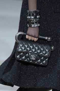 From Furry Helmets to Globe Handbags, Let's Take a Closer Look at All the Fall 2013 Chanel Accessories: They used up all the chains on the boots, so this bag gets a sturdy carrying bar instead.