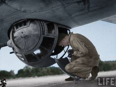 Maintaining Sperry ventral ball turret on a B-17 Flying Fortress