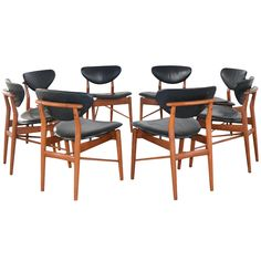 Set of Eight chairs by Finn Juhl | From a unique collection of antique and modern dining room chairs at http://www.1stdibs.com/furniture/seating/dining-room-chairs/
