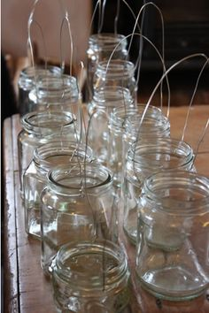 These would be great with battery powered candles and votives if they are hanging near trees and flamable things. How to make Homemade jam jar lanterns – by The Natural Wedding Company. Jam Jar Crafts, Do It Yourself Wedding, Deco Originale, Wedding Table Decorations, Church Decorations, Homemade Party Decorations, Wedding Centerpieces, How To Make Homemade, Glass Jars
