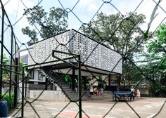 Two thousand ice-cream tubs form the walls of this small community library in Bandung, Indonesia, and some of them have been perforated to display a subtle message