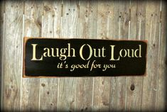 This wooden sign reads Laugh Out Loud Its Good For You. It measures approx 25Wide x 7.25High. It has been painted then sanded and distressed for a
