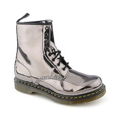 Silver metallic Dr. Marten's boots - A combat inspired boot from the Dr. Marten's collection. The 1460 W features a leather upper, 8 eyelet lace up, stitching details, pull tab on heel, and a cushioned sole for all day comfort. - $89.99 on sale!