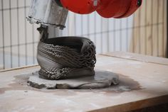 code merges with clay matter through a robot's dance …