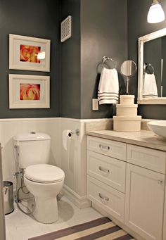 Budget Bathroom Reno - Two Loonies and a Penny (love the paint color contrasted with the creamy white and the orange accents)