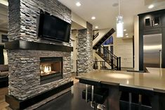I like the black, gray and silver modern/contemporary kitchen details with the light gray stacked stone