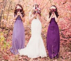 Purple Bridesmaid Dresses. I love the idea of each girl having a different dress and the light/dark look awesome together.