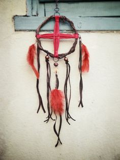 dreamcatcher- red leather weave with copper beads and triangle, red feathers, brown leather fringe by Sailor's Omen. $45.00, via Etsy.