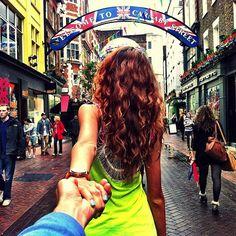 Girlfriend Leads Him Around the World